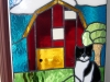 stained glass barn scene with cat