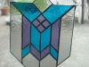 geometric stained glass in blue, purple, and clear