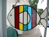 colorful striped stained glass fish