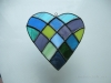 Patchwork heart made with all cool colors of glass.
