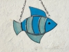 """Made of blue rough roll and blue/white wispy glass. Eye is a light blue wiggle eye securely glued on. Seams are polished silver. Measures 4 3/4 """" wide by 4"""" tall. Fish in this pattern are $15 each."""