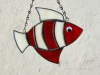 "Made of translucent white and deep red glass. Eye is a white wiggle eye securely glued on. Finished in a pewter patina. Measures 4 3/4 "" wide by 4"" tall. Fish in this pattern are $15 each."