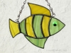 """Made of light green wispy and yellow wispy glass. Eye is a bright green wiggle eye securely glued on. Finished in a pewter patina. Measures 4 3/4 """" wide by 4"""" tall. Fish in this pattern are $15 each."""