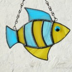 Striped fish in blue and yellow wispy glass