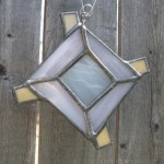 In light pink and white, small God's eye/Ojo de Dios ornament