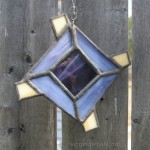 Small God's eye ornament, with two shades of purple glass