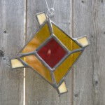 Stained glass god's eye ornament