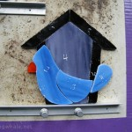 Purple birdhouse with blue bird, work in progress