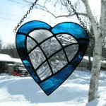 Blue stained glass heart with clear glass inlaid patchwork heart