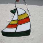 Stained glass sailboat with two stripe sail. $30 plus shipping.