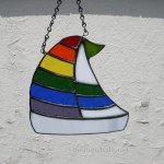 Stained glass sailboat with multi stripe sail. $35 plus shipping.